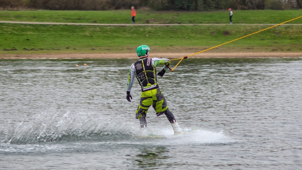man riding with wakeboard package
